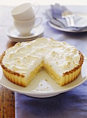 Lemon meringue tart, a piece cut