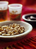 Bowl of pistachios in Middle Eastern setting