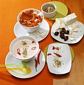 Yoghurt dip with chili pepper and carrot dip with capers