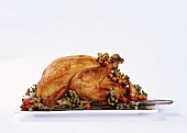 Roast turkey with bay leaves and berries
