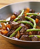 Lamb goulash with green beans in beer sauce