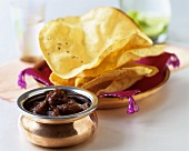 Tamarind and date chutney with poppadom