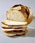 Round wheat-rye bread, slices cut
