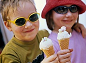 A girl and a boy with ice cream cones