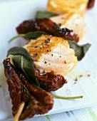 Salmon, dried tomatoes and sage leaves on a skewer