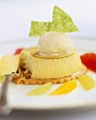 Lemon cheesecake garnished with ice cream and citrus fruits
