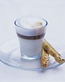 Espresso macchiato with almond fingers