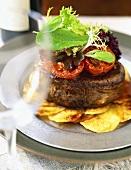 Beef fillet on fried potato slices
