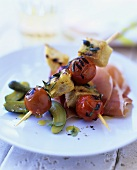 Tomato and bread kebabs on Parma ham