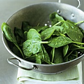 Fresh spinach leaves in a colander