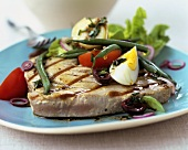 Barbecued tuna steak with green beans and boiled egg