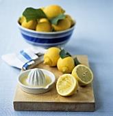 Lemons and lemon squeezer with lemon juice