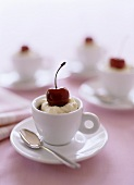 Coffee cream with cherry in coffee cup