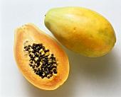 Half and whole papaya