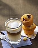 Latte macchiato and two muffins