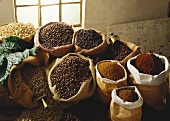 Roasted and unroasted coffee beans and ground coffee
