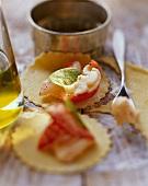 Making ravioli with lobster filling