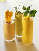 Three shakes with mango, avocado and papaya