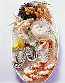 Mixed seafood platter with cocktail sauce