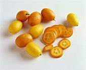 Whole and sliced kumquats