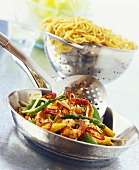Pan-cooked vegetables with shrimps and noodles