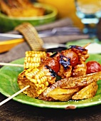 Barbecued vegetable kebabs and potato wedges