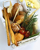 Basket of bread rolls and herbs
