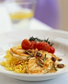 Monkfish with tomatoes, anchovy sauce and saffron rice