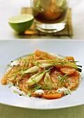 Salmon carpaccio with spring onions and crème fraîche