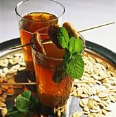 Tamarind lemonade on a tray with pumpkin seeds