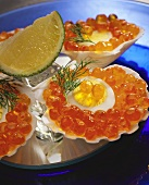 Scallop shell with egg and salmon caviare