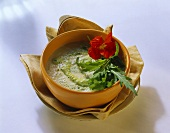 Creamed herb & vegetable soup with rocket & nasturtium flowers