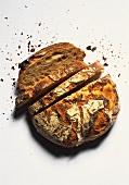 A crusty farmhouse loaf, slices cut