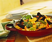 Paella with mussels in frying pan