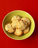 Lemon and redcurrant biscuits in yellow bowl