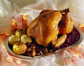 Christmas turkey with red cabbage, chestnuts & baked apples