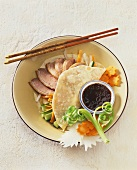 Peking duck with soy sauce and carved vegetables (China)