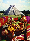 Chili con carne in front of Mexican pyramid
