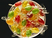 Coloured sweets, wrapped in cellophane, in a bowl