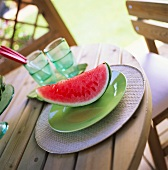 Wedge of watermelon on laid table