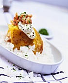 Baked potato with sour cream and shrimps