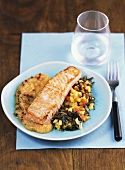 Salmon steak with fruit salsa and wild rice
