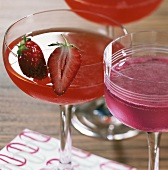 Two cocktails: 'Strawberry Cosmopolitan' & 'Cosmopolitan'