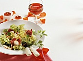 Lettuce with radishes; tea lights, rose petals & red wine