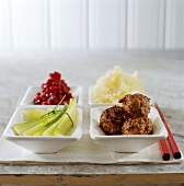 Meatballs with cucumber, cranberries and mashed potato