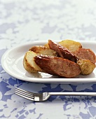 Fried sausage slices with potatoes