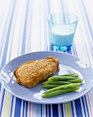 Pork chop with mustard crust, served with green beans