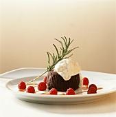 Small chocolate cake with coffee meringue, raspberries, caramel
