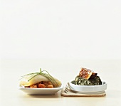Wonton on cloudberries and scallop with herbs and fig