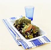Vine leaves stuffed with lamb on olives